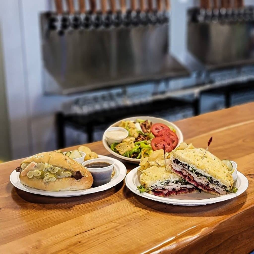 dees brothers brewery serving up three plates of food in downtown sanford